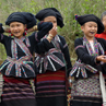 H'mong hill tribe ladies.  Known as Black Hmong because of the colour of their dress and the blackening of their front teeth using charcoal.
