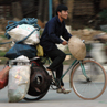 Cyclist in Hanoi (you would be amazed just what they can carry!) - Vietnam.