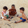 Children playing on the beach at Caravelas - Brazil.